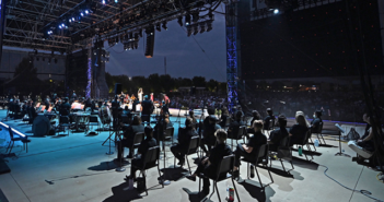 A backstage view of the performers and L-Acoustics loudspeaker arrays supplied by Firehouse Productions
